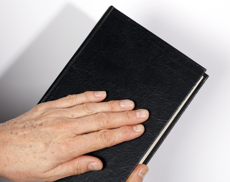 bibliomania: hand on the Holy Bible