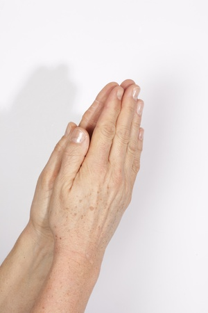 clasped: Image of praying hands  Stock Photo