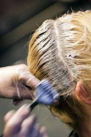 scalp: Closeup view during hair dyeing treatment ...