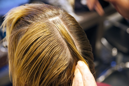Closeup view during hair dyeing treatment ...