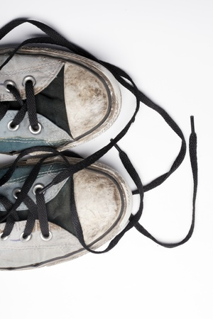 An old pair of trendy canvas shoes