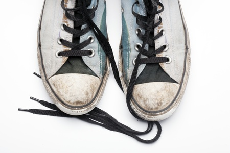 An old pair of trendy canvas shoes photo