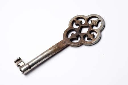old key on a white background photo