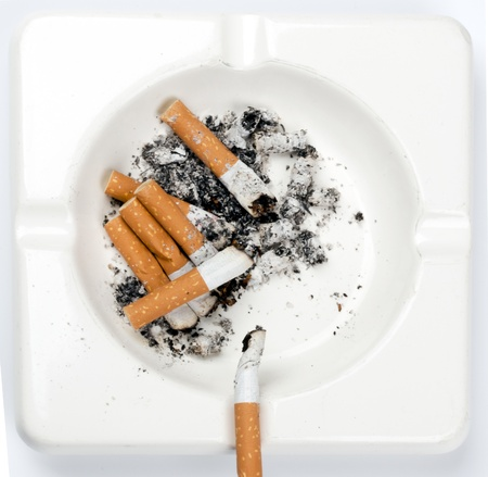 ashtray full of cigarettes on white Stock Photo - 12043188
