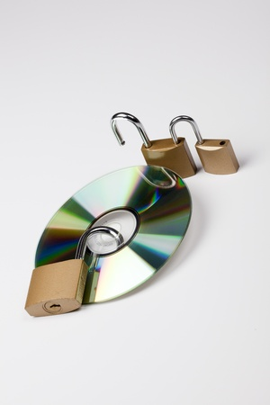 data security with cd and lock Stock Photo