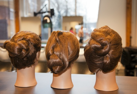 Different hair design models, a students accessory in a hair dressing school. photo