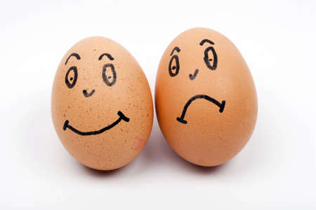 two eggs one happy and one unhappy