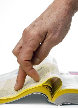 search trough the yellow paper Reklamní fotografie - 12525477
