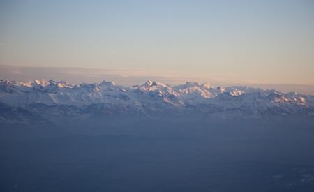 Sky and alps from an airplane window Stock Photo - 12870400