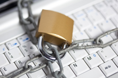 identity protection: computer security with laptop and chain