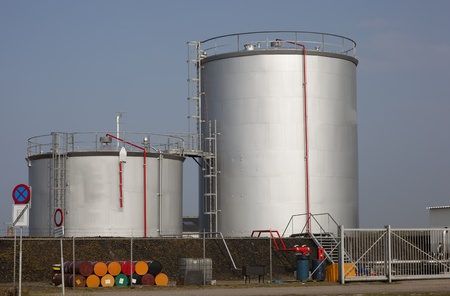 industrial site: oil tanks with blue sky Editorial