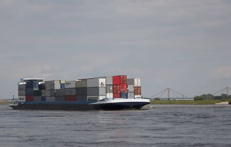 containership: containership nearby tiel, the netherlands Stock Photo