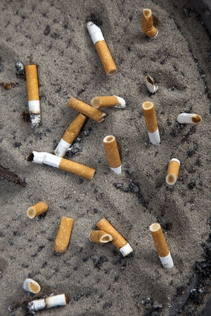 astray: cigarettes in a astray