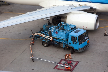 refueling a plane on the airport