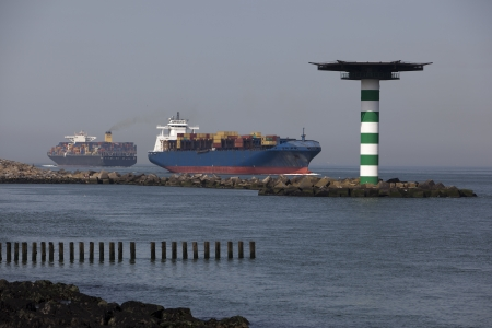 containership: containership nearby the harbour of rotterdam