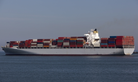 containership nearby the harbour of rotterdam photo