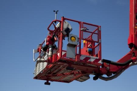 Articulated aerial hydraulic platform against a blue sky  Reklamní fotografie