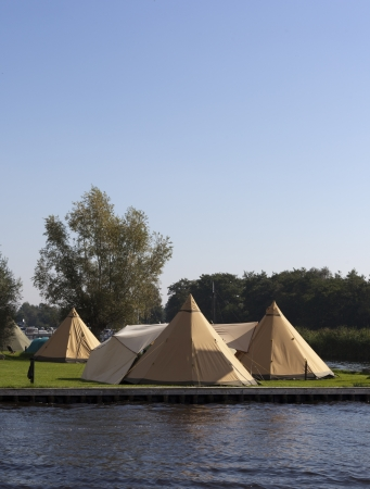 tipi: tipi tents on a dutch camping with blue sky