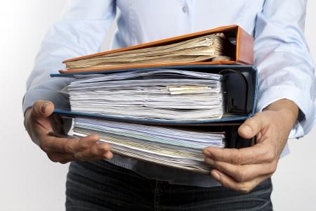 bureaucratic: woman carrying binders