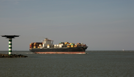 containership nearby rotterdam, netherlands