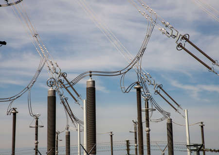 Electric power transmission lines in the evening. High voltage switchgear and equipment of power plant