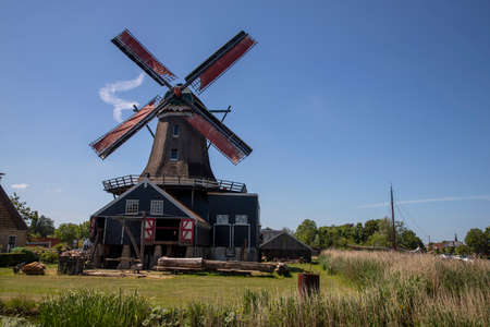Old dutch windmill with blue sky