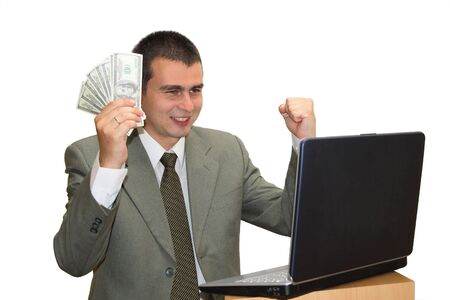 moneymaker: Young businessman with money in hand and laptop celebrating his success