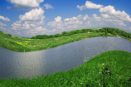 Photo of summer landscape - river, meadow and blue sky with clouds Stock Photo - 3749891