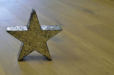 meta: Star on wooden floor