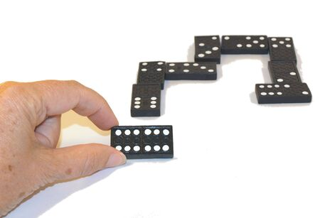 double game: Game of dominoes being played Stock Photo