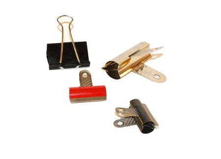 clamps: Paper clips and clamps on white background