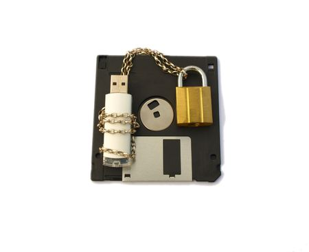 padlocked: Computer data stick, wrapped with silver chain and padlocked with gold padlock, lying on a floppy disk. Isolated white background. Stock Photo