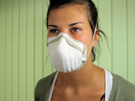 surgical mask woman: Young woman wearing viral protective face mask.