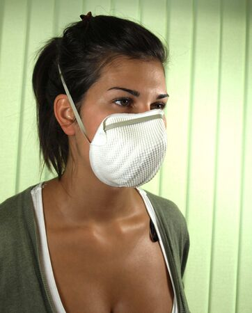 hygeine: Young woman wearing viral protective mask Stock Photo