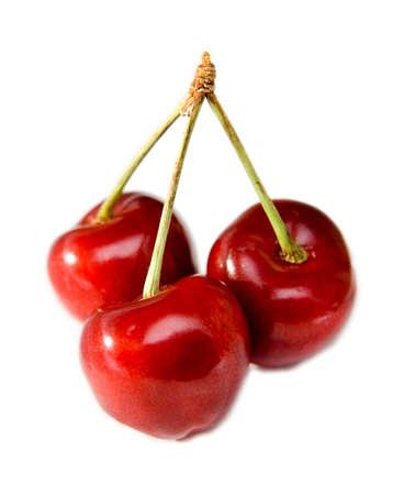 cherries isolated: Three sweet cherries isolated Stock Photo