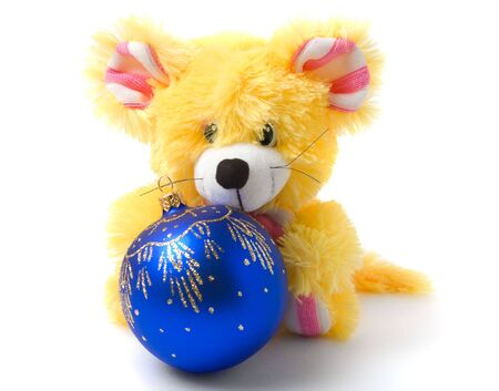 Yellow mouse toy with blue christmas ball photo