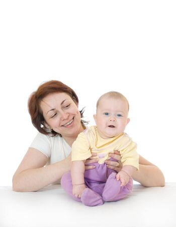 Small smiling baby with mother on white Stock Photo - 2842375