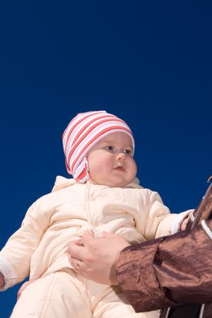 Small baby on mother hands over blue sky Stock Photo - 2878633