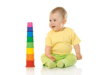 Small baby with toy pyramid #3 isolated on white