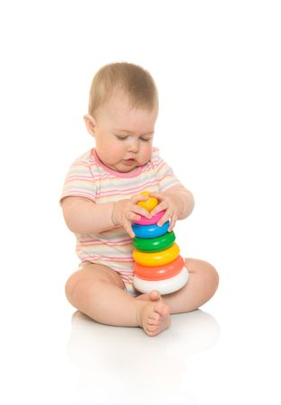Small baby with toy pyramid, isolated on white photo