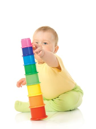 Small baby with toy pyramid photo