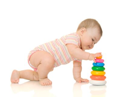 Small baby with toy pyramid #5 isolated on white photo