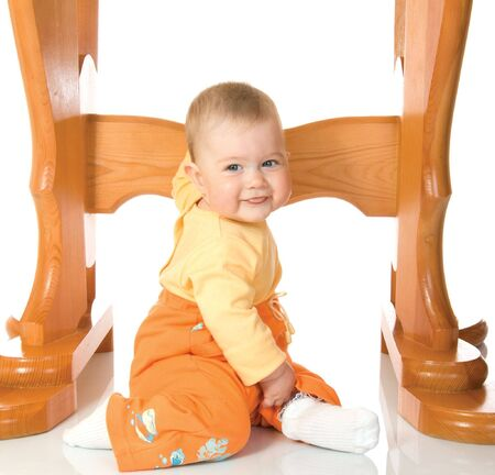 Small baby sitting with table #7 isolated on white photo