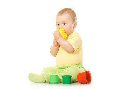 Small baby with toy pyramid #6 isolated on white Stock Photo - 3314913