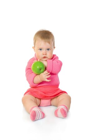Small baby with green apple isolated on white photo