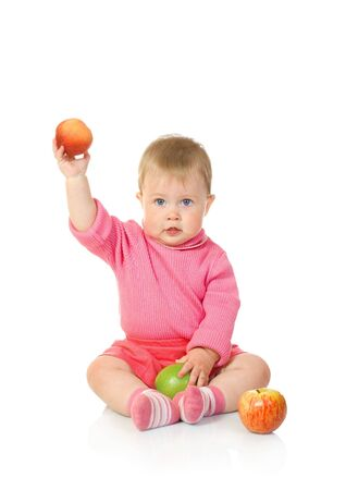 Small baby with apples isolated on white photo
