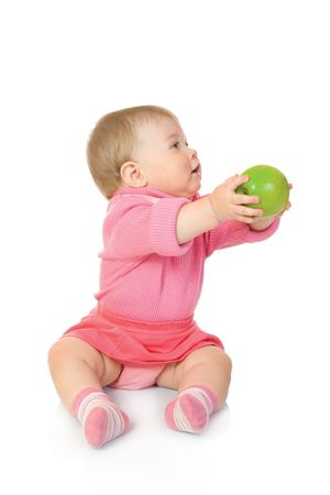 Small baby with green apple #2 isolated on white photo