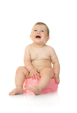 Small smiling baby on pink chamber-pot photo