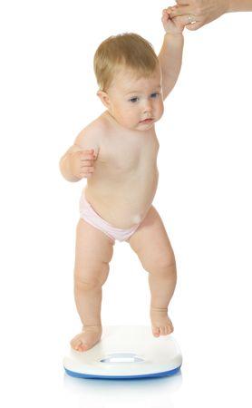 Kleine baby op huis schalen geïsoleerd op wit # 5 Stockfoto