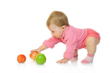 Kleine baby met appel # 8 op wit wordt geïsoleerd Stockfoto